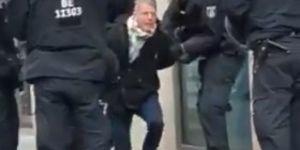 Alman polisi milletvekiline ters kelepçe takıp yerde sürükledi